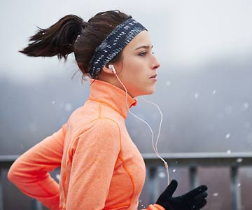 woman jogging in cold winter weather
